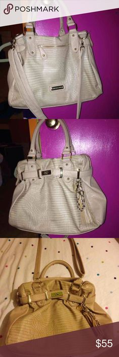 Rare Steve Madden purse Beige snake skin purse so cute with a subtle amount of texture. Has short and long straps what I love Is how light weight it is. It has a lot of room as well! Shows minimal wear from everyday use. Steve Madden Bags Shoulder Bags
