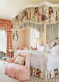 Love the color blends, the red curtains somehow match the pink and roses!