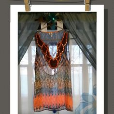 Top Super cute sleeveless top, with  sequins&beads decorative neckline. Really nice colors and print. Back has a cut out pattern. Great summer top. 100% Polyester   Studio Y Tops Tank Tops