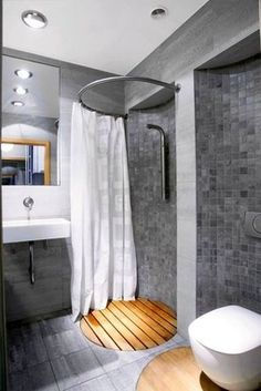 for the small bathroom. Interesting shower, love the use of timber! So clever