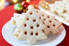 Skip the mess involved in decoSkip the mess involved in decorating Christmas cookies with icing. These Raspberry Filled Christmas Tree cookies are just as beautiful as iced Christmas cookies but require less time and skill and don't make nearly the mess. | QueenofMyKitchen.com #christmas #christmascookies #christmascookieideas #christmascookieexchange