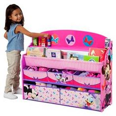 <p>Make your girl's bedroom or play space extra-special with a little help from Minnie Boasting colorful graphics of Minnie and Daisy, this Minnie Deluxe Book & Toy Organizer from Delta Children features five fabric bins and a two-tiered bookrack supported by a sturdy wood frame.</p><p> </p><p>• Recommended for ages 3-6</p><p&#62...