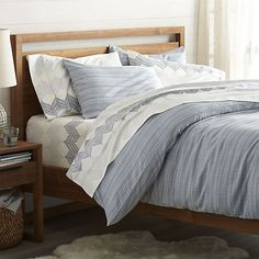 Combed cotton yarn and long staple fibers dyed in rich tonal blues are woven on a dobby loom to create elegant, classic bed linens. Remarkably soft hand creates a cozy covering that mixes well with other patterns. Reversible duvet is finished with a button closure; pillow shams have an overlapping back closure.