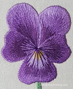 A silk shading piece designed by Tanja Berlin and stitched by Catherine Patterson. The pansy has blossomed into a beautiful purple flower!