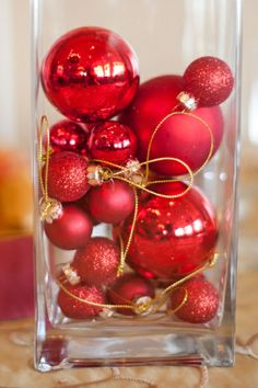 6 Original Wedding Centerpieces   Hosting a winter wedding? Fill vases with ornaments that coordinate with your wedding color palette. These bright red baubles are eye-catching and add a hint of seasonal fun. They are a cost-effective way to add holiday cheer to your wedding reception space.