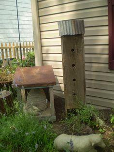 birdhouse beeskep in garden