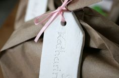 Clay name tags - could tint another color?  Cool idea for birthday gifts or homemade give aways