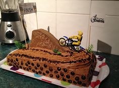 My son wanted a motorcross cake so I made this for him. I used brown sugar to look like dirt chocolate sprinkle chunks to look like rocks etc. Dirt Cupcakes, Monster Cupcakes, Cupcake Cakes, Motorcross Cake, Motorbike Cake, Dirt Bike Birthday, 5th Birthday Cake, Beautiful Cakes, Amazing Cakes