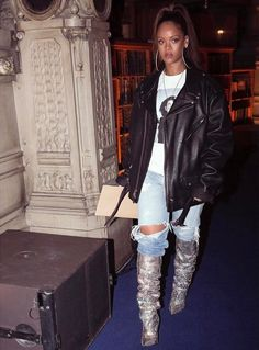 Rihanna Saint Laurent crystal boots, Schott NYC classic Perfecto leather jacket, Raf Simons Patti Smith photo sweatshirt