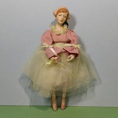 INTERNATIONAL SALES WELCOME. Just contact us for shipping quote. Here Is a Pretty Porcelain Ballerina In Pink Top with Cream Color Tulle Tutu. She stands 8 1/2 tall, and is posed and poised for dancing wearing her ballerina slippers (pointed toes). Sweet gift for balletomane (bal lay toe