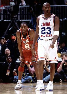 Kobe Bryant VS Michael Jordan.  Detail: Kobe with a pair of AIR jordan shoes.