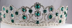 The Emerald Royal Empress Rhinestone Beauty Pageant Queen, Princess, Crown Tiara For a romantic and elegant look in a tiara, this design is both versatil and charming. The tiara is adorned with emeral