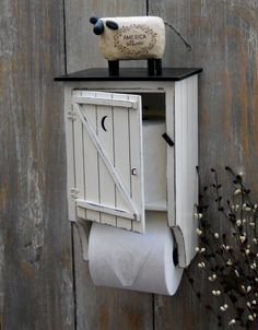 Cute outhouse toilet paper holder.