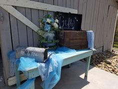 Antique blue table with gift chest and mailbox with flower arrangement sitting on top