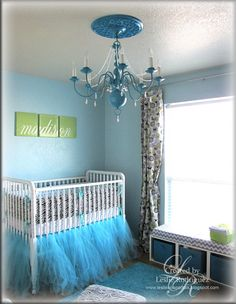 love the blue tulle around the bottom of the crib- this is happening if it ends up being a girl, when planning on it being a boy... haha