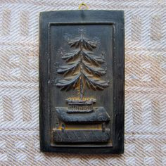 FEATHER TREE Cast Black BEESWAX Primitive Very Detailed Ornament. $5.50, via Etsy.