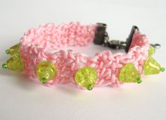 $21.99 This is a feminine and youthful spin on black leather and steel spiked jewelry with its soft pink polyester crocheted cording and lime green glass spike beads.