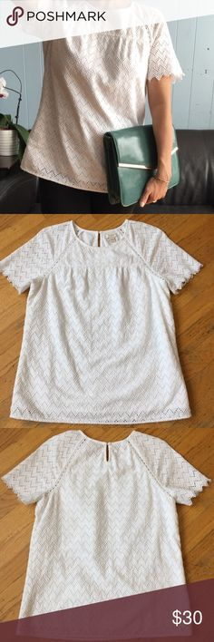 J CREW Eyelet T-shirt Gorgeous T-Shirt. In excellent good condition. With back keyhole with button closure. J. Crew Tops Blouses