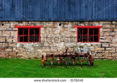 stock-photo-rusted-antique-tiller-beside-an-old-blue-and-stone-barn-with-red-windows-3178248.jpg 450×320 pixels