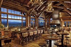 Big Sky Journal - A roaring open-hearth fire warms the bar area of the Trailhead Lodge great room.