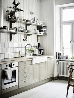 pale olive cabinets   photo anders bergstedt