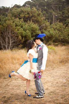 Alice inspired wedding. Love the blue sash / shoes!