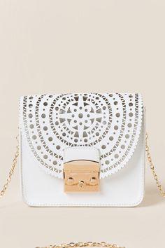 Margoth Medallion Crossbody Bag. #bags #bagsdesigner #ad #bagscute #bagscanvas #bagstravel #bagstote #bagsleather #bagsboho