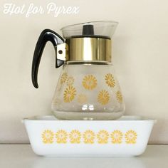 Day 80 of 100 - So, I have already shared a picture of my sunflower patterned bakeware, but today I wanted to share a picture of the matching glass carafe a fellow collector clued me in to.  How weird is it that this carafe is relatively easy to find in a pattern that is rare?  #100hfp #pyrexpassion #pyrex100 #htfpyrex #hotforpyrex #pyrexlove #pyrexia #pyrexporn #pyrexaddict