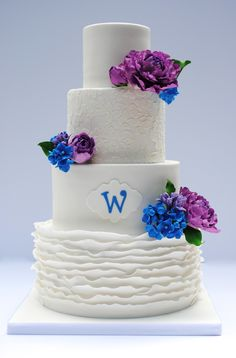 Gumpaste peonies, hydrangeas, and lilacs in wildberry and royal blue