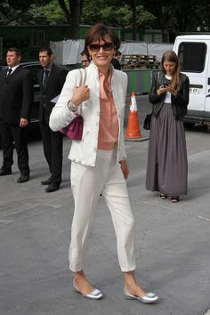 """Ines de la Fressange was recently featured in a """"best dressed"""" list, with a notation that not only did they love her all white ensemble with the pop of soft color, but that she inspired them to wear flats.  I'm all for anything that inspires women to wear flats."""