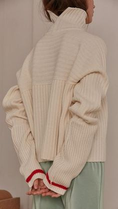 Jupe Sweater in Ivory. Cowl neck ribbed sweater with pointed dropped shoulder seams and extra long raglan sleeves. Designed to be loose fit.