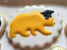"Yellow UC BERKELEY, ""GO CAL!"" BEAR COOKIE with oval scalloped cookie cutter from Angelcakesetc on Etsy!"