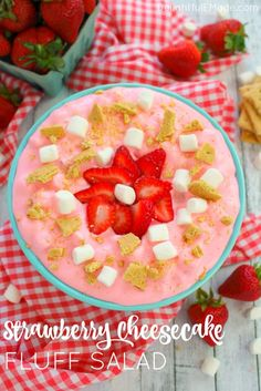 This creamy, delicious strawberry marshmallow fluff is the ultimate summer salad! Made with fresh strawberries, marshmallows, cream cheese, jell-o and whipped topping, this easy strawberry fluff salad recipe will be your new go-to cookout dish!