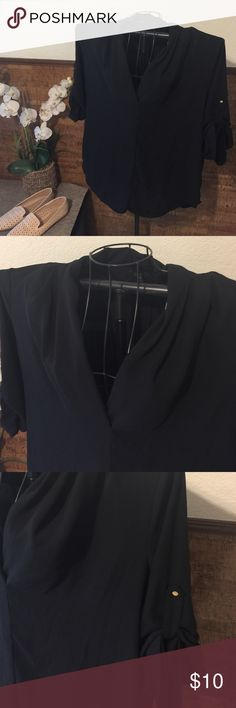 Black V neck utility blouse Great office attire black V neck utility top with 3/4 sleeve with lovely gold button accent on sleeve. Great for the office or paired with a great pair of jeans and flats. Like new condition Mossimo Supply Co Tops Blouses