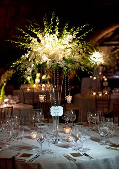 White Dendrobium orchid centerpiece arrangement, white wedding flowers, high centerpiece, tall arrangement, hanging candles