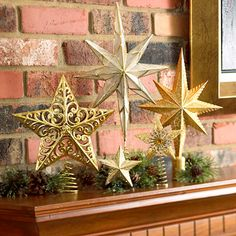 Starry Night  Group golden star tree toppers to make your mantel shine. If the stars have a tendency to tip, use pea-size balls of clear candleholder wax to hold them upright.