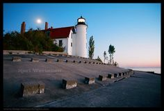 Lighthouses make great subjects to photograph. Take a look at this lighthouse, the color and the way the line of blocks lead your eyes around makes this a winner. You be the judge of it
