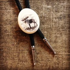 Vintage Scrimshaw Bolo Tie Moose Bolo Tie -Signed Scrimshaw Manuk ($75) ❤ liked on Polyvore featuring home and home decor