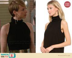 Margaux's black sleeveless turtneck top on Revenge.  Outfit Details: http://wornontv.net/30252/ #Revenge