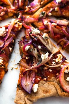 NYT Cooking: I use a perforated grill pan to cook sliced onions and other vegetables on the grill. They'll have a nice charred flavor and be just soft enough if you cook them before you put them on the pizza.