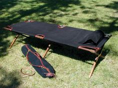 One of our favorite versatile pieces: folding wood camp cots. Here are three options: