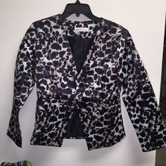 Beautiful Animal Print Leopard Blazer I ordered this blazer online because I thought it was so beautiful. I ordered a 3XL and this is DEFINITELY NOT THAT SIZE. LOL  This blazer was made in China, and I would say it's a small or medium. It's gorgeous and brand new! Jackets & Coats Blazers