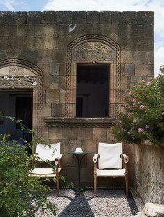 Jasper Conran- Island of Rhodes, Greece. Campaign chairs in a courtyard