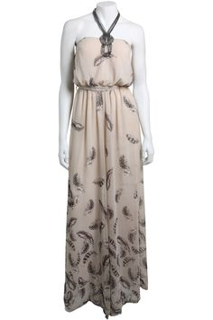 This Cream Feather Print Jumpsuit by Little-Mistress has the appeal of a maxi dress but with more panache!