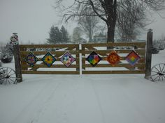 Nice idea....mini quilts across the gate in Ilderton, Ontario, Canada