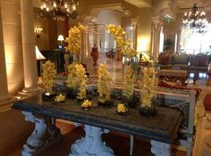 Inspired by the warmth of fall, this orchid arrangement is a taste of sunshine in the Ritz Carlton lobby! Would you decorate your fall wedding with these fun florals?