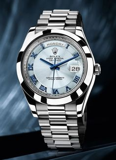 Rolex Oyster Perpetual Day/Date. Blue Face with Roman numerals. Only comes in platinum