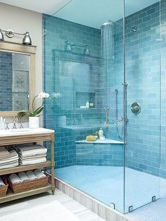 Blue Bathroom With Grey Marbled Tile Floor And A Vintage Wooden Vanity Beach House Bathroom, Beach Bathrooms, Small Bathroom, Blue Bathrooms, Blue Bathroom Tiles, Turquoise Bathroom, Ocean Bathroom, Coastal Bathrooms, Blue Tiles