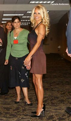 Pamela Anderson. just look at that jealous lady next to her! :D