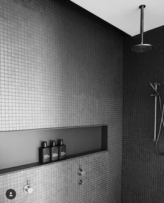 Built-in shower shelves.